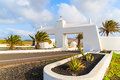 Road and gate to costa teguise town with palm trees gateway lanzarote canary islands spain Royalty Free Stock Photo