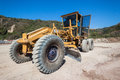 Road grader earthworks civil heavy duty machine on construction site on site at durban solid waste for improvements close up color Stock Photo