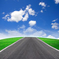 Road and green field Royalty Free Stock Images