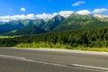 Road in green summer landscape of Tatra Mountains in Zdiar village, Slovakia