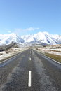 A road heading towards the snowy mountains of canterbury new zealand Royalty Free Stock Images