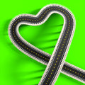 Road heart d green in the background Royalty Free Stock Images