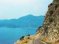 Road in high mountains along mediterranean coastline Stock Photos