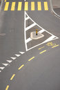 Road intersection with yellow zebra crossing and bicycle lane high angle view Stock Photo