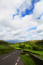 Road in lake district scenic view of receding through green countryside of national park cumbria england Royalty Free Stock Photo