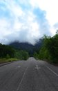 Road leading into jungle mountains Royalty Free Stock Photos