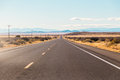 Road leading to distance a view of a the on a dry grassy plain Stock Images