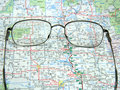 Road map and glasses Royalty Free Stock Photos