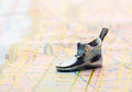 Road map with statuette shoeswith selective focus shoes Stock Photo