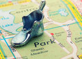 Road map with statuette shoeswith selective focus shoes Stock Photos