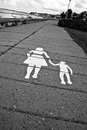 Road marking indicating walking area Stock Photos