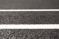 Road markings new asphalt with Royalty Free Stock Images