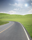 Road through the meadow and hillside. Royalty Free Stock Photo
