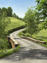Road through a meadow sunny green landscape with countryside Royalty Free Stock Image