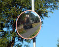 Road mirror convex at the intersection for traffic safety Royalty Free Stock Photo