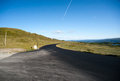 Road through mountain plateau valdresflye jotunheimen norway Royalty Free Stock Images