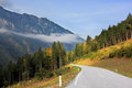 Road in the mountains beautiful autumn day austrian alps of beginners yellowing pines and spruces Stock Photos