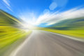 Road in the mountains a blurred image with patches of sunlight Royalty Free Stock Photos