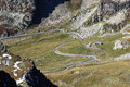 Road in mountains on italian side to great st bernard pass Stock Photography