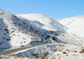 Road in the mountains through snowy crown range south island new zealand Stock Image