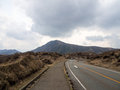 Road with mountains and storm clouds japan Royalty Free Stock Photos