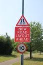Road narrows and new road layout signs Royalty Free Stock Photo