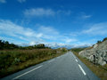 Road norwegian with clouds in the background Royalty Free Stock Image
