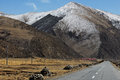 On the road nyingchi tibet driving highway to at early spring time snowy mountain as background china Royalty Free Stock Photos
