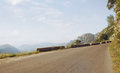 Road panoramic view of nice summer empty through the mountain Royalty Free Stock Images