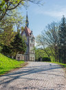 Road paved with cobbles leading to the castle former carpathian residence of count schonborn of th century and clock tower of Stock Image