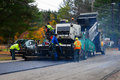Road paving equipment resurfacing a village street Royalty Free Stock Photography