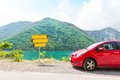 Road pointer red car in mountains and Stock Photo