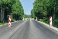Road reconstruction countryside asphalt in forest Royalty Free Stock Image
