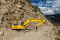 Road reconstruction in mountains himalayas construction excavator lahaul valley himachal pradesh india Stock Image