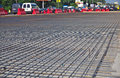Road repairs renewal of the asphalt paving on the metal grid on the concrete base Royalty Free Stock Photo