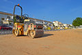 Road roller a being used to flatten a sandy surface Royalty Free Stock Photography