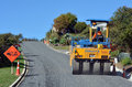 Road roller cable bay nz apr on asphalt pavement works repairing there are more than four million miles of highways and roads Stock Image