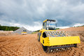 Road roller compacting soil compactor and bulldozer during construction works Stock Photography