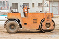 Road roller at construction site. Royalty Free Stock Photo