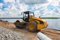 Road roller vibration machine compacting the soil for asphalt pavement during construction roadworks and repair quay Stock Photography