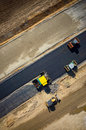 Road rollers working on the construction site aerial view Royalty Free Stock Photo