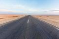 Road in salt lake Chott el Djerid in desert in Tunisia Royalty Free Stock Photo