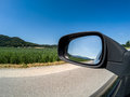 Road and side mirror good sunny weather Royalty Free Stock Photo
