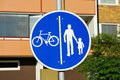 Road sign blue for bicycle and pedestrian traffic Stock Photo
