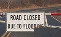 Road sign closeup view of closed due to flooding Stock Photo