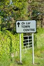 Road sign direction to town centre in rural ireland Royalty Free Stock Image