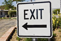 Road sign helps give which way to exit Stock Photo