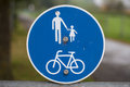 Road sign informing pedestrians and cyclists Royalty Free Stock Photo