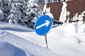 Road sign in snowy day in winter Royalty Free Stock Images