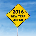 Road sign with a text of 2016 new year ahead Royalty Free Stock Photo